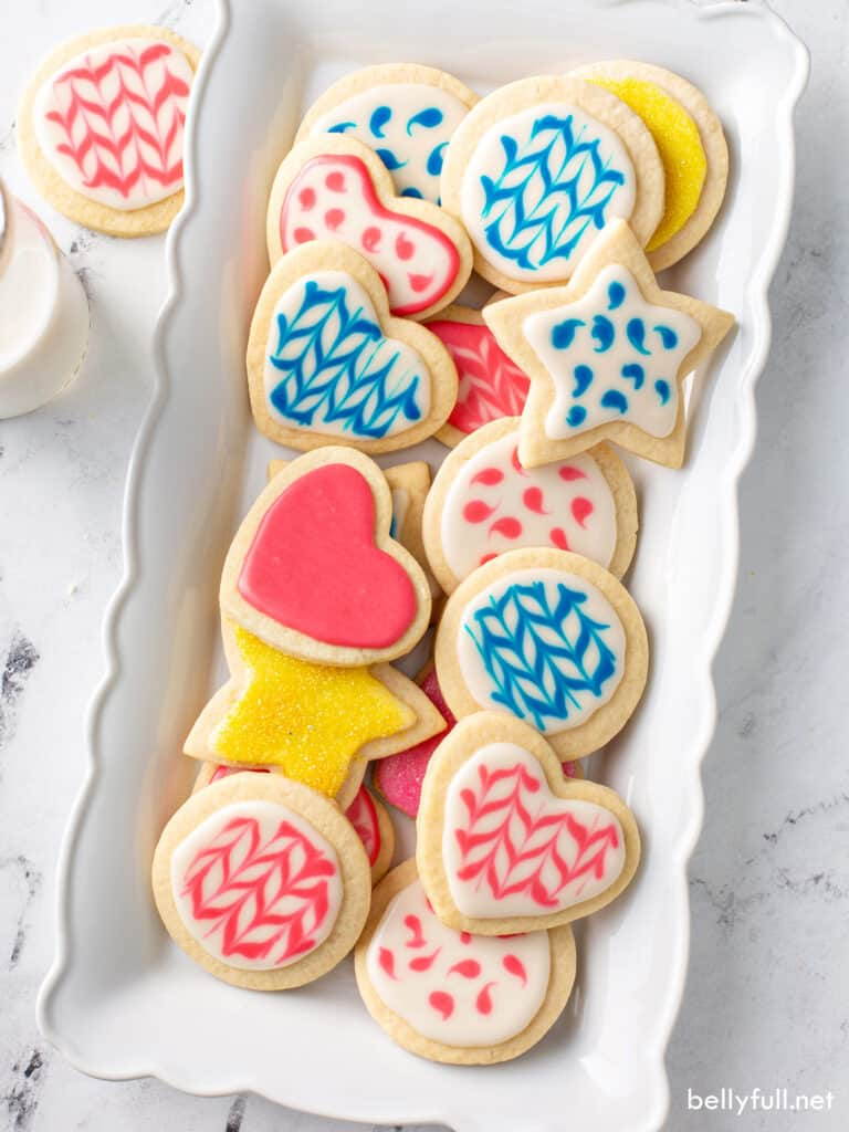 decorated cookies in blue, pink, and yellow sugar cookie icing