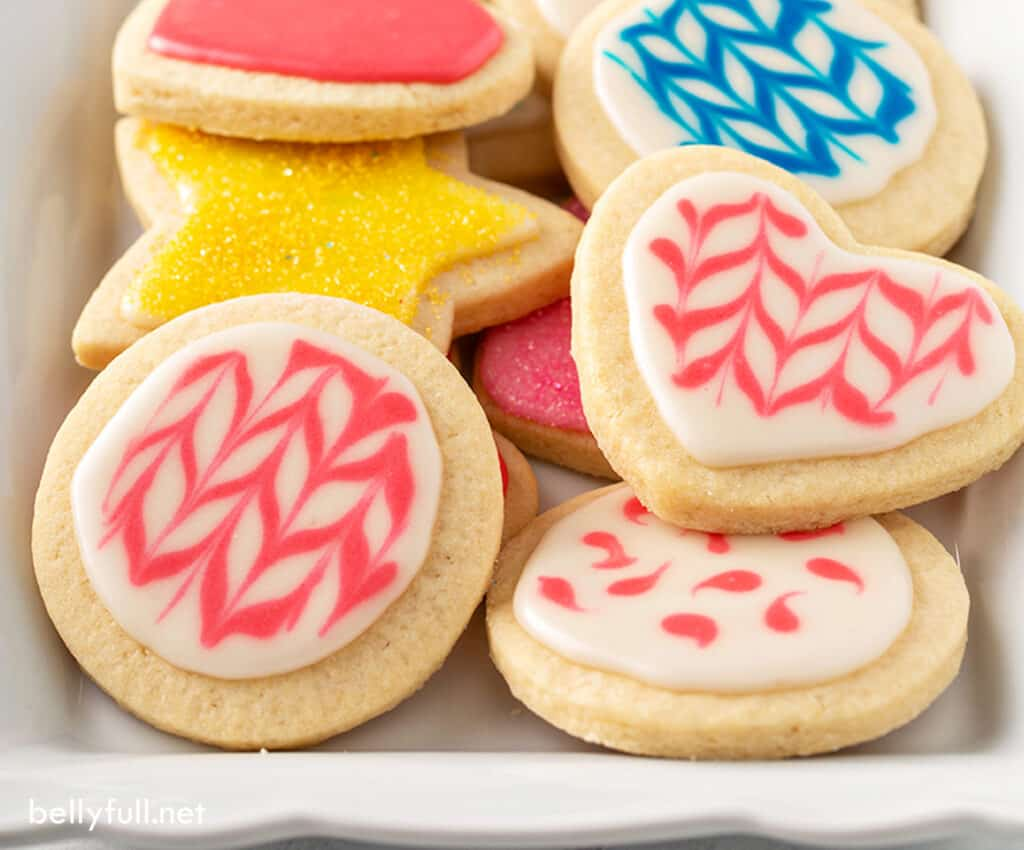 cut out sugar cookies decorated in pink icing