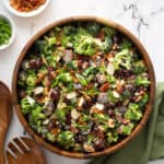 overhead of broccoli salad in wooden serving bowl