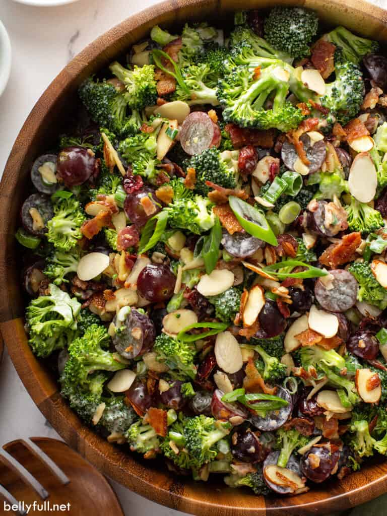 overhead close up of broccoli salad in wooden serving bowl