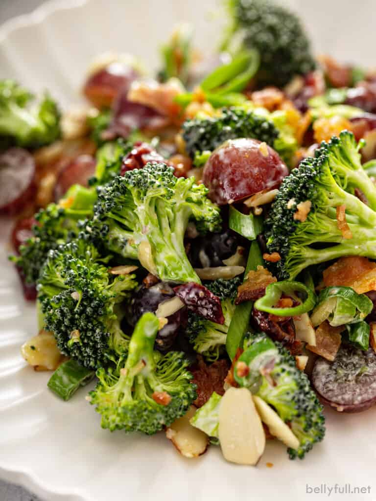 close up portion of broccoli salad on white plate