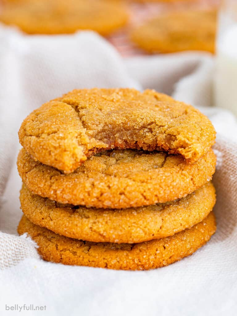 stack of 4 brown sugar cookies with top one bite taken