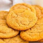 pile of brown sugar cookies on white plate