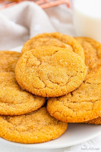 pile of brown sugar cookies on white plate