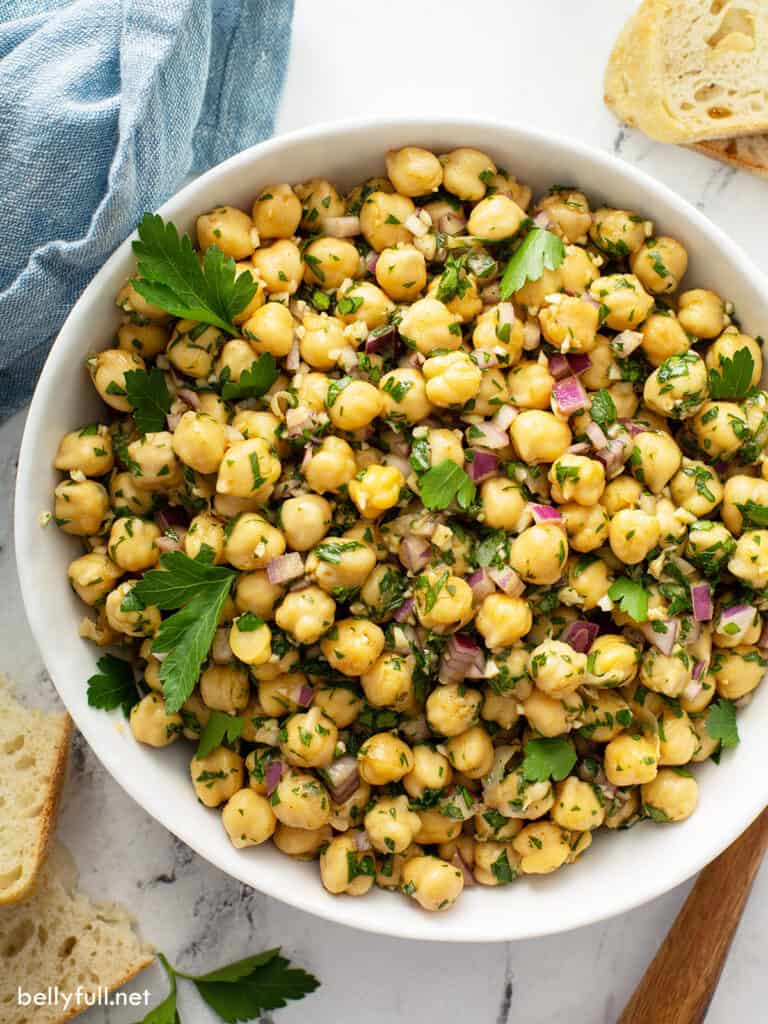 overhead close up white serving bowl filled with Chickpea Salad