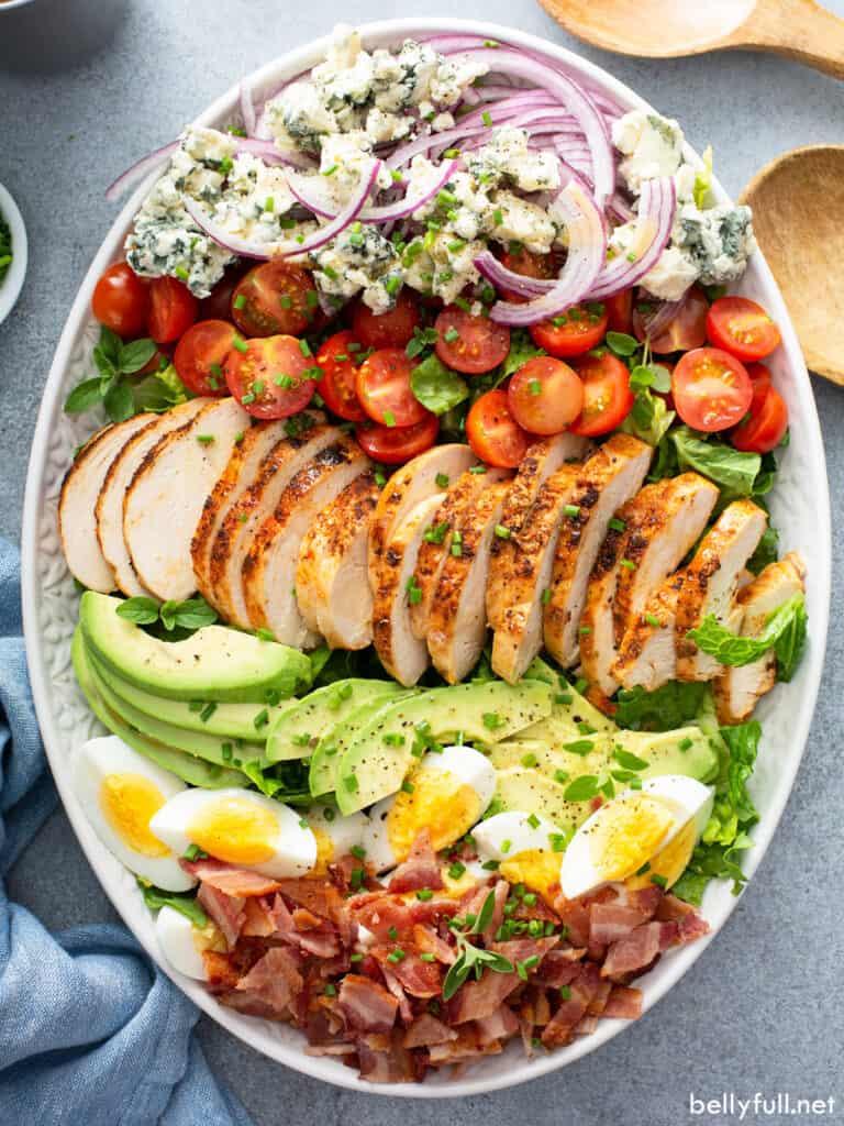 overhead Cobb Salad on white serving platter