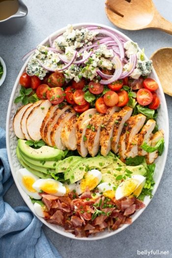 overhead Cobb Salad on white serving plate
