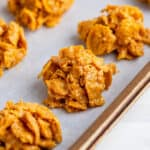 cornflake cookies on parchment paper