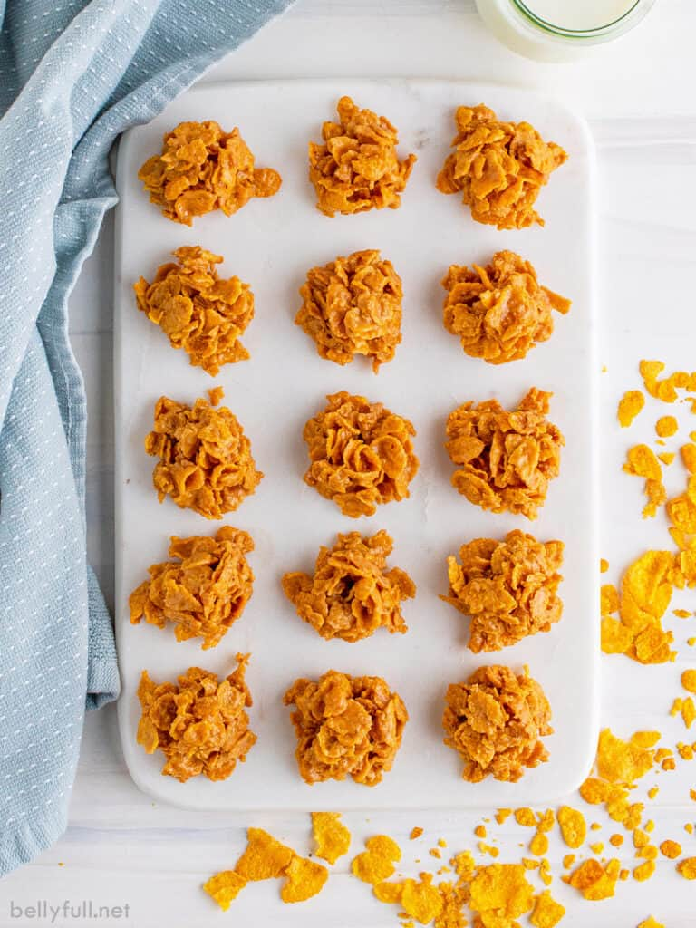 15 mounds of Cornflake Marshmallow Cookies on cutting board