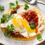 Huevos Rancheros on plate with fork