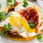 Huevos Rancheros on plate with fork