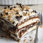 ice cream sandwich cake on white plate with fork