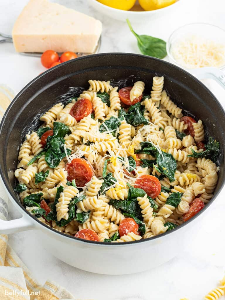 Creamy Lemon Pasta with tomatoes and spinach in pot