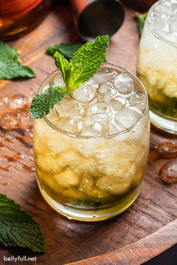 Mint julep cocktail on wooden board
