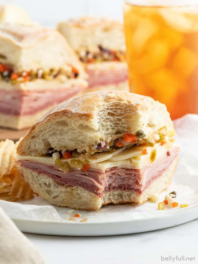 Muffuletta sandwich with bite taken