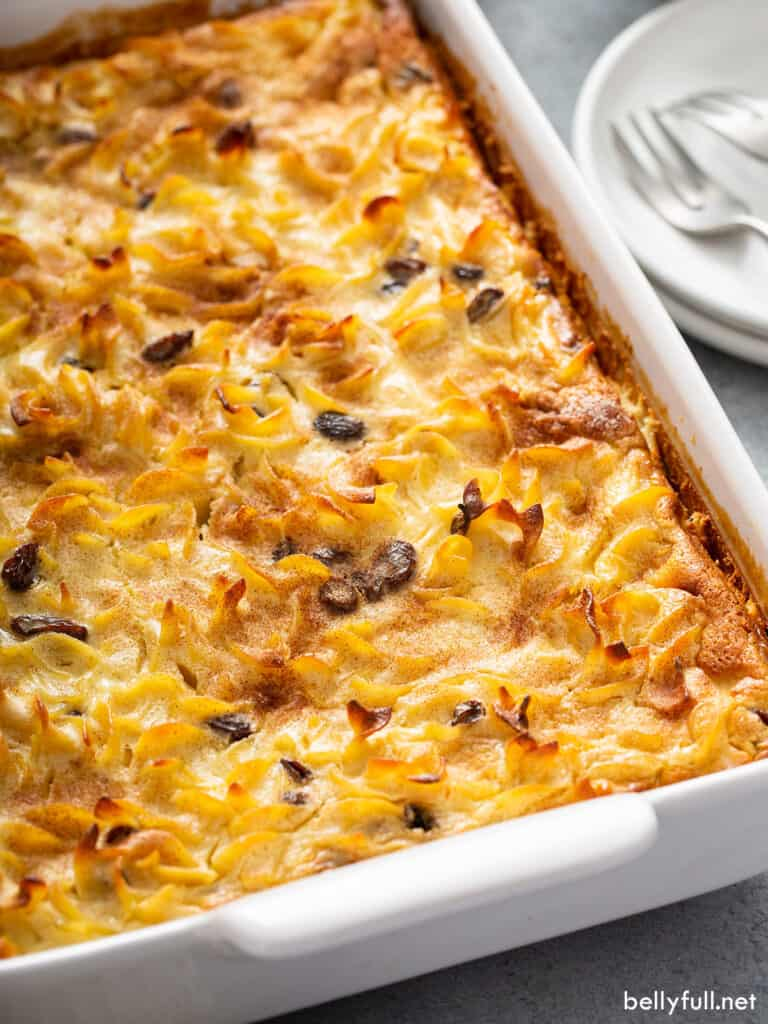 Noodle Kugel with raisins baked in a white casserole dish