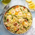 overhead of Orzo Salad with shrimp, asparagus, and tomatoes in serving bowl