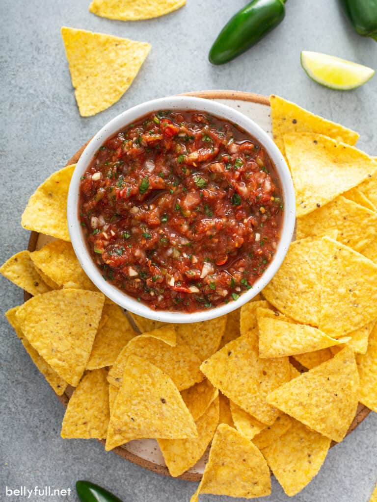 overhead salsa in white dish surrounded by tortilla chips
