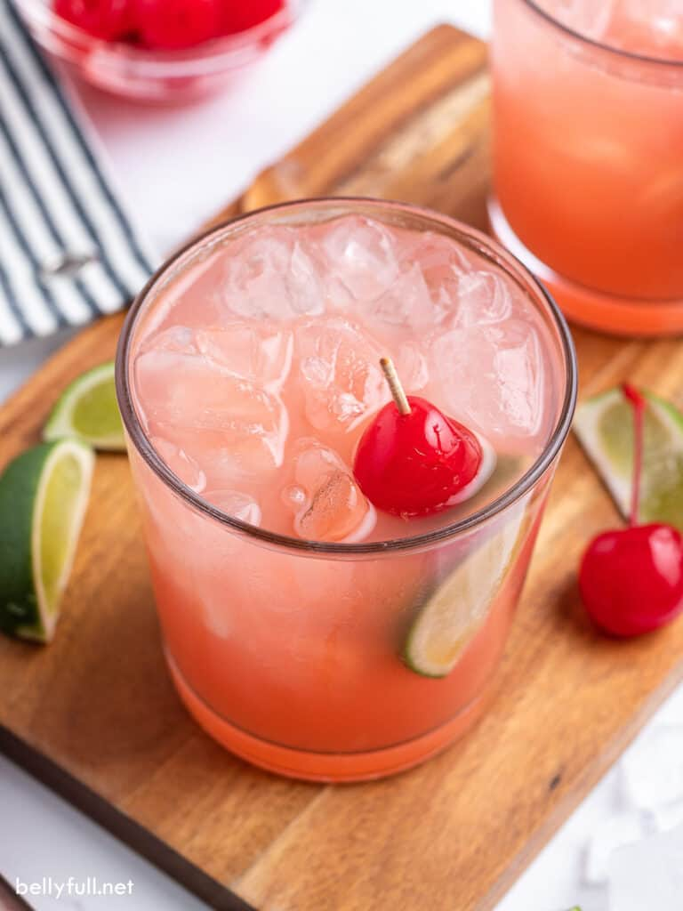 Sea Breeze Cocktail in high ball glass with cherry garnish