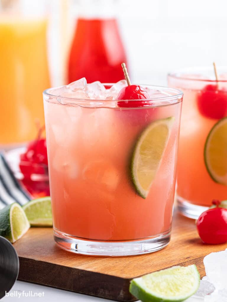 Sea Breeze Cocktail with cherry and lime wedge