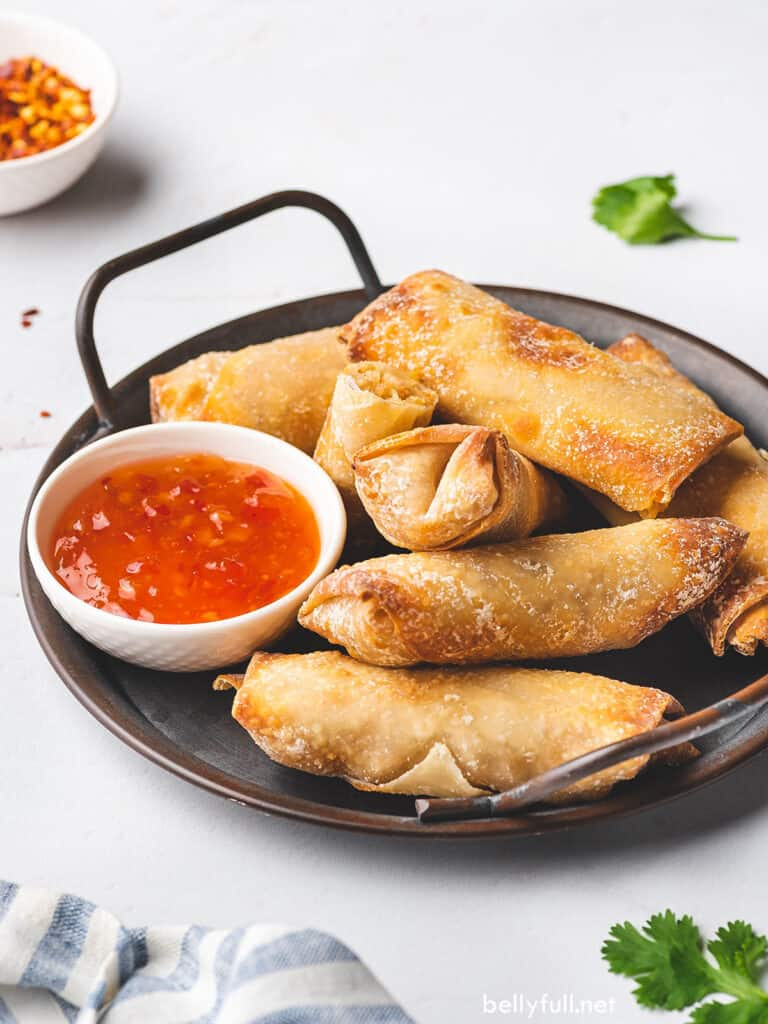 air fryer egg rolls on serving platter with sweet chili sauce