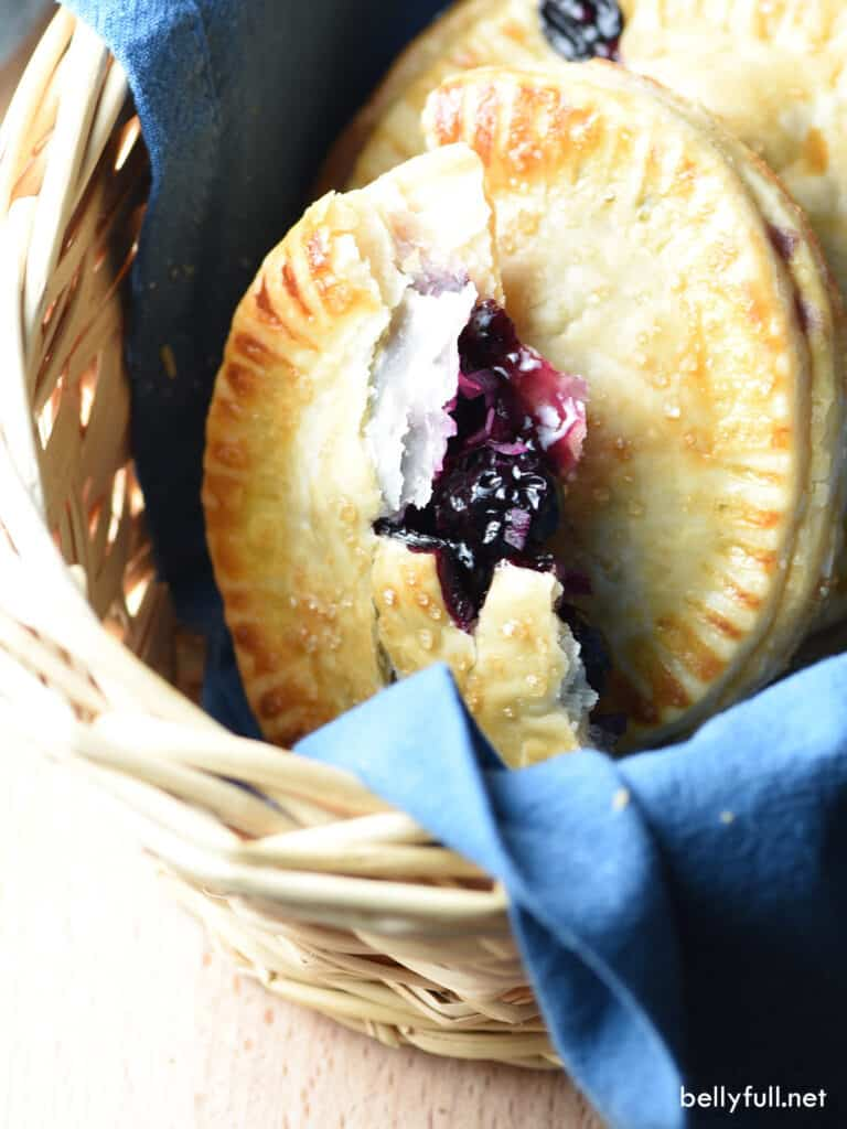blueberry hand pie cut in half with filling exposed