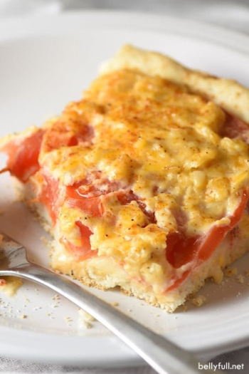 slice of tomato biscuit casserole on white plate
