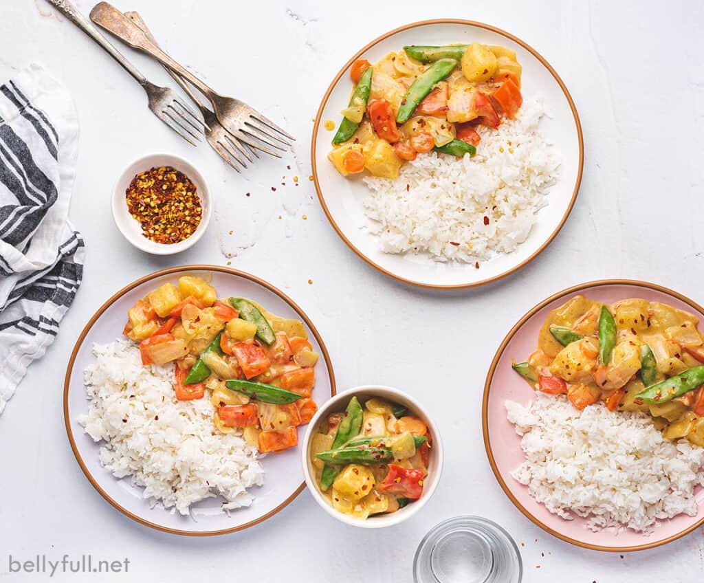 3 plates of coconut curry veggie stir fry
