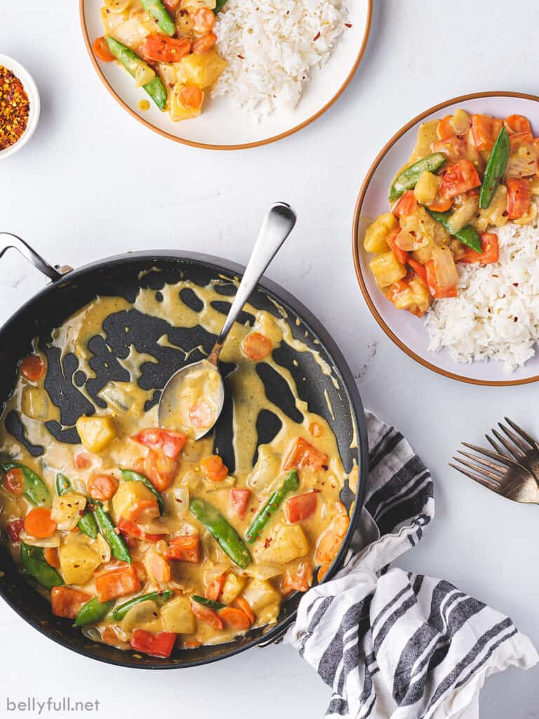 overhead coconut curry vegetable stir fry in skillet