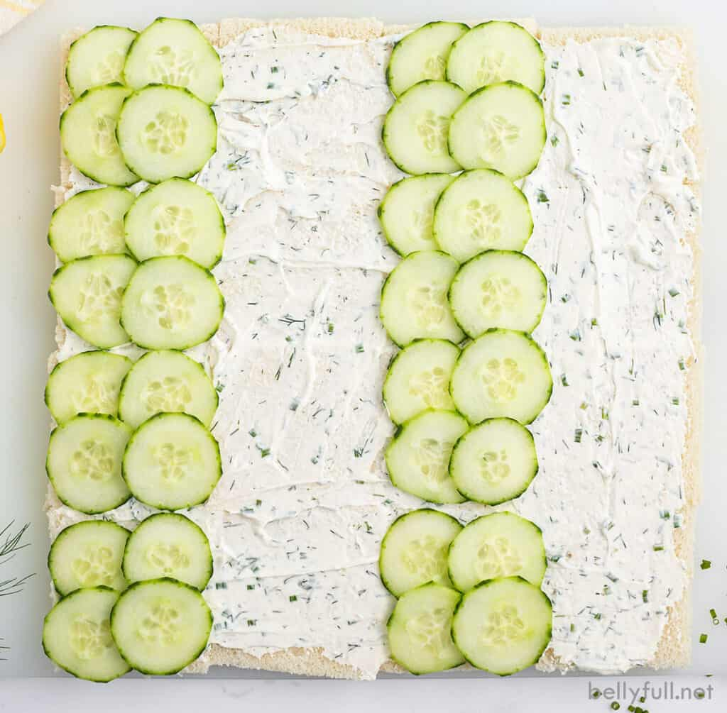 bread with herbed creamed cheese and sliced cucumbers
