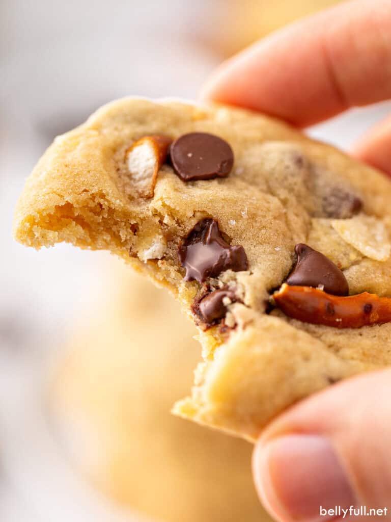 close up chocolate chip pretzel cookie with bite taken