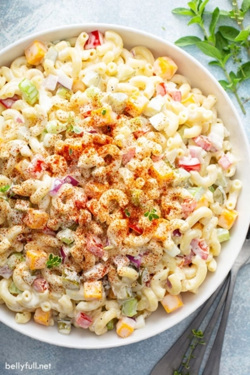 overhead view of macaroni salad in white serving bowl