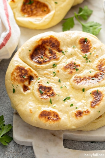naan basted with butter and parsley