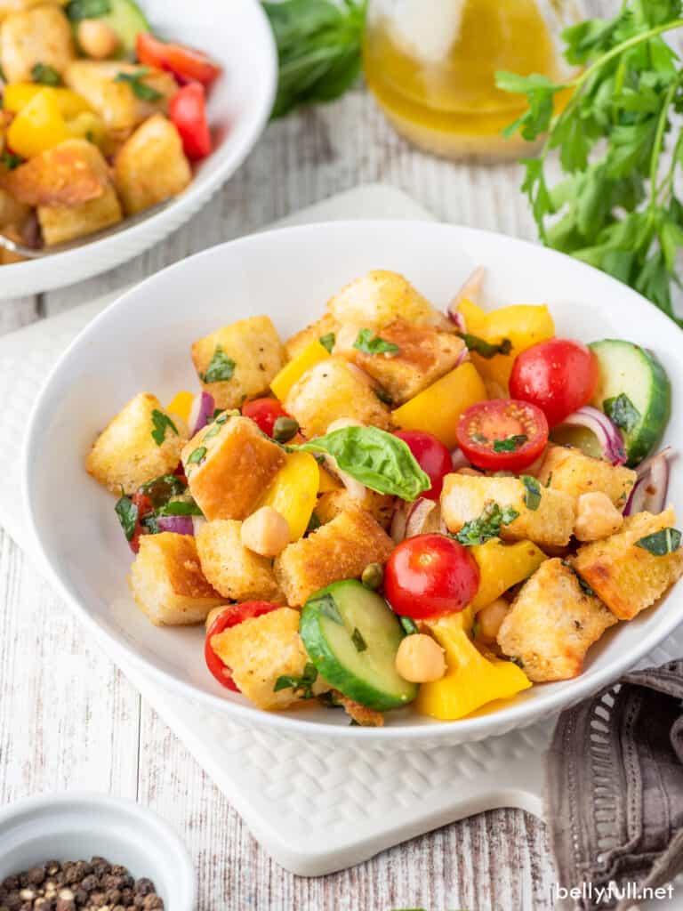 panzanella salad in white bowl
