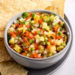Bowl of pickle de gallo surrounded by tortilla chips