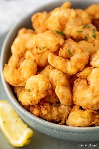 close up bowl filled with popcorn shrimp