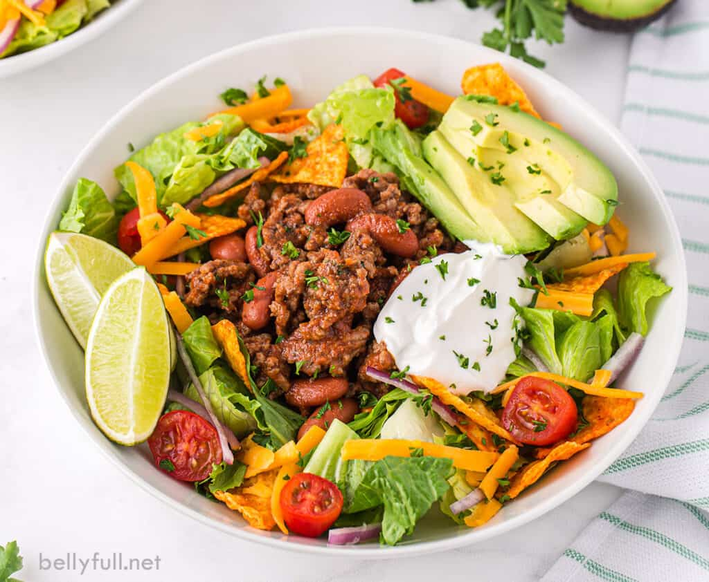 Doritos salad with ground beef in bowl