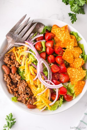 overhead taco salad in white bowl