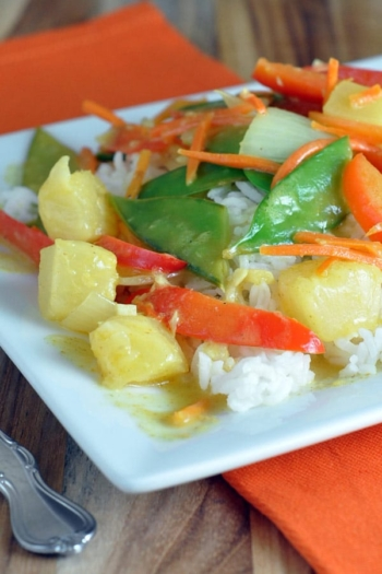 stir fry veggies over white rice on plate
