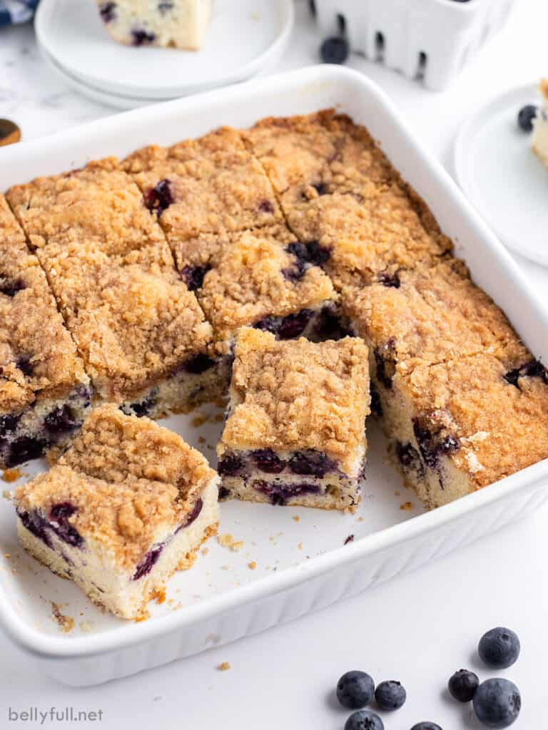 blueberry coffee cake slices in white baking dish