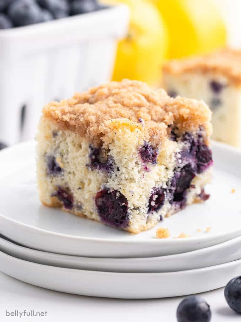 square slice of blueberry buckle cake on white plate