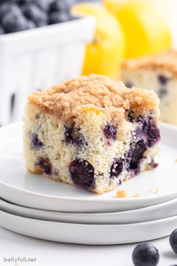 square piece of blueberry buckle cake on white plate