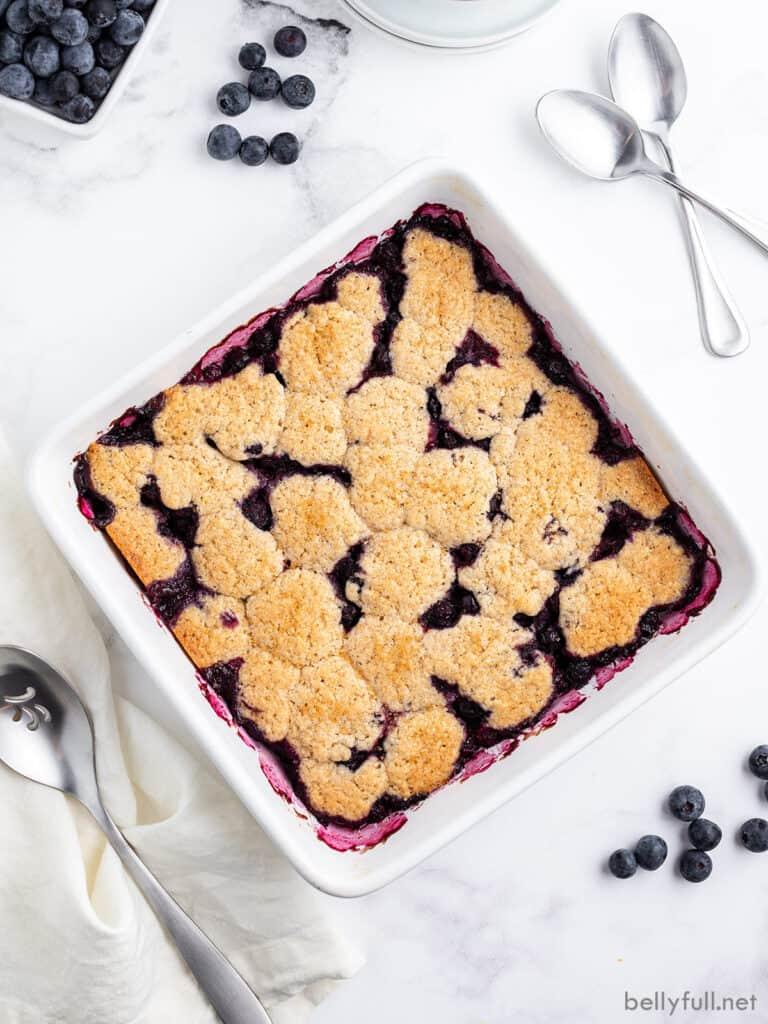 overhead baked berry cobbler in white dish