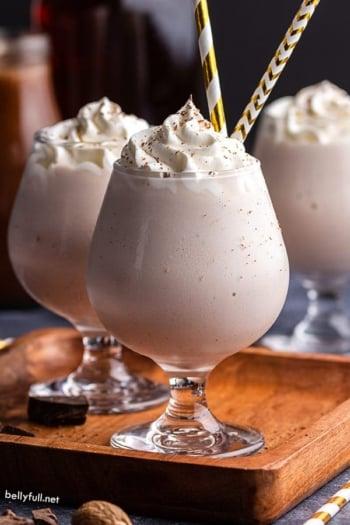 Brandy Alexander Milkshake in dessert glass with gold striped straws
