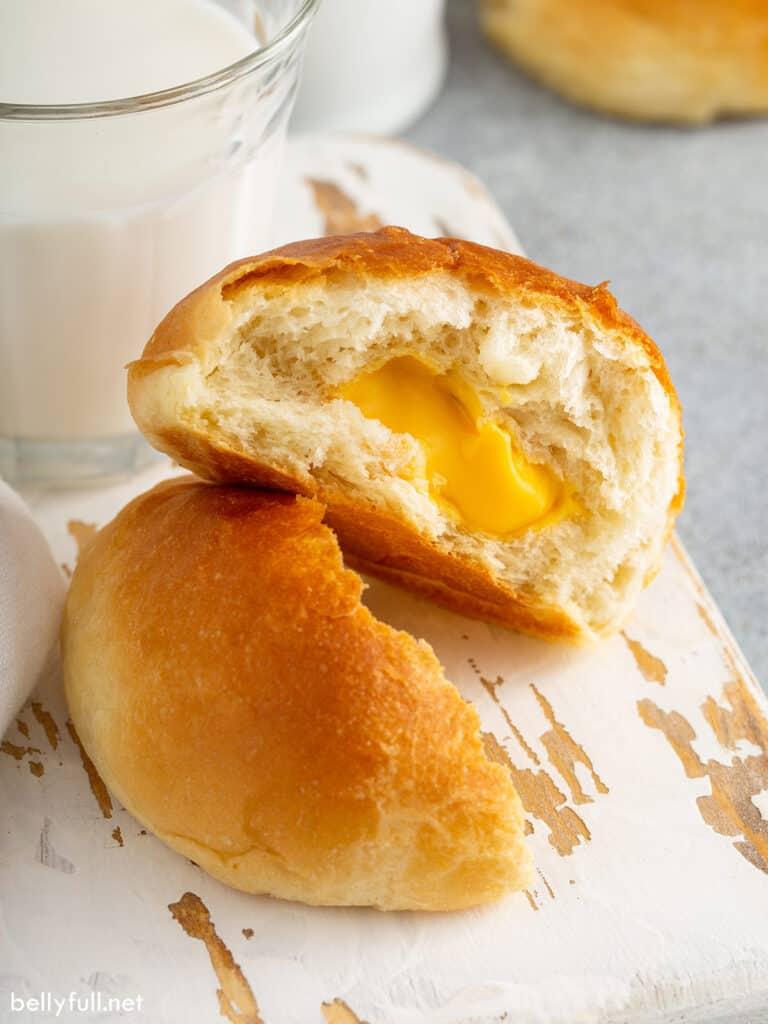 cheese stuffed bread roll split in half