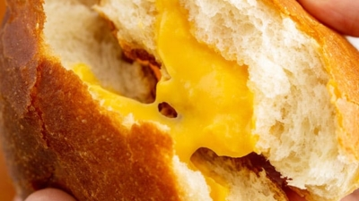 close up image of cheese zombie being split in half
