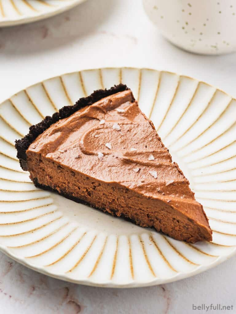 slice of silky chocolate pie on ornate plate