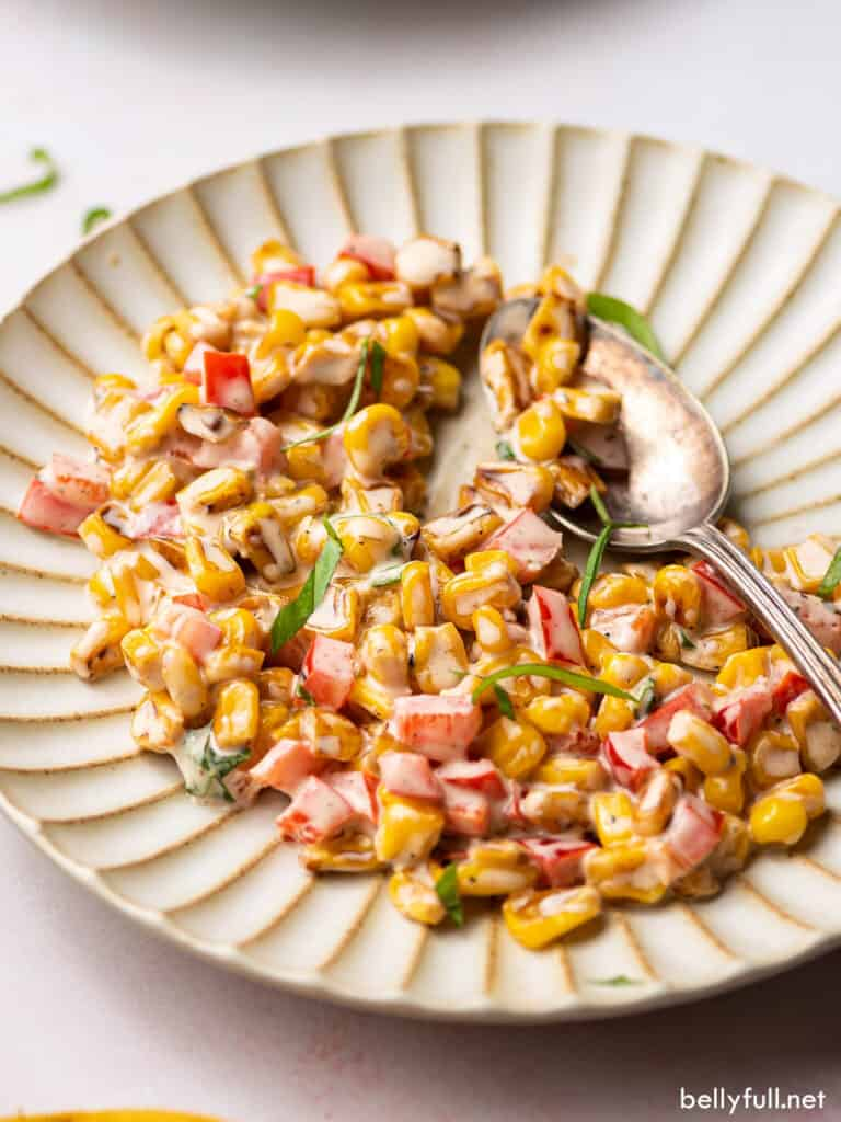 grilled corn, bell pepper, and basil salad on plate