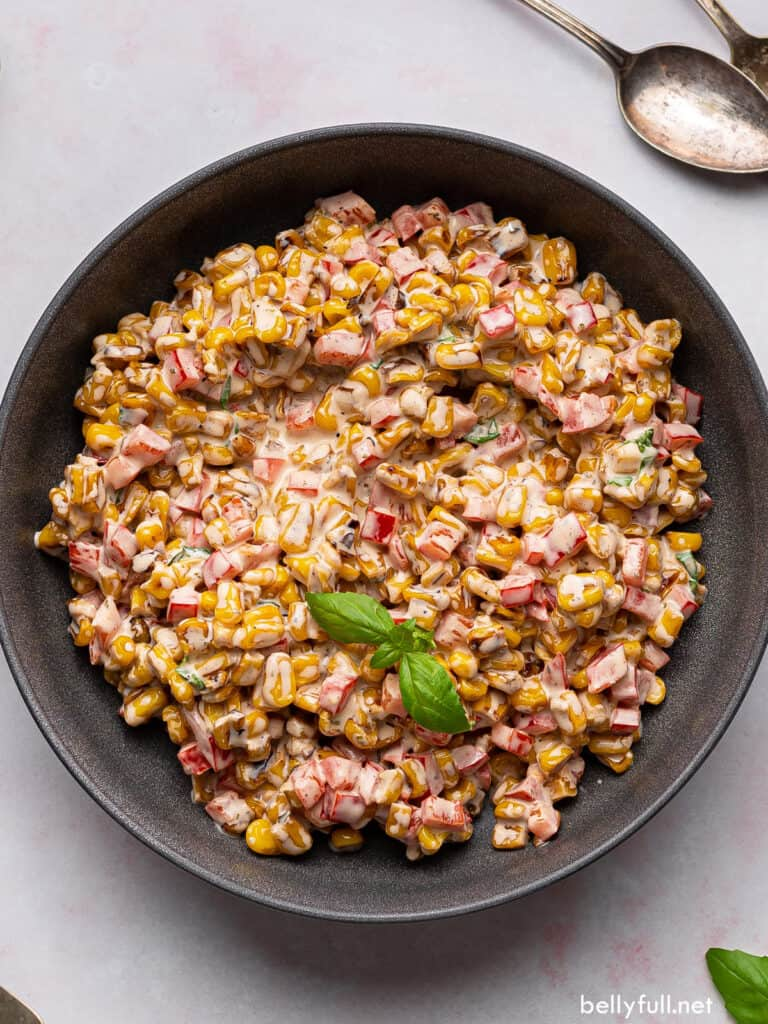 overhead creamy corn salad in black serving bowl