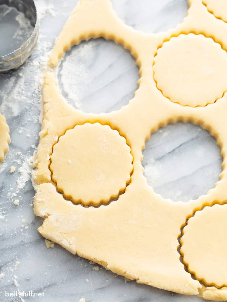 raw cookie dough with cut out shapes